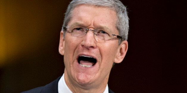 Apple CEO Tim Cook testifies on Capitol Hill in Washington, Tuesday, May 21, 2013, before the Senate...