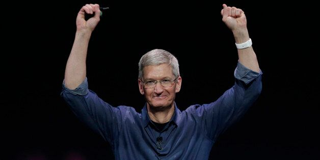 Apple CEO Tim Cook introduces Apple Watch , which he is wearing on his wrist, on Tuesday, Sept. 9, 2014,...