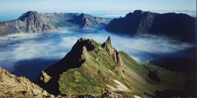 The peaks of Mount Paektu, the highest on the Korean peninsula, in June 1999. Many Koreans consider the...