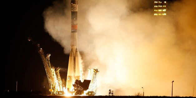 The Soyuz-FG rocket booster with Soyuz TMA-16M space ship carrying a new crew to the International Space...