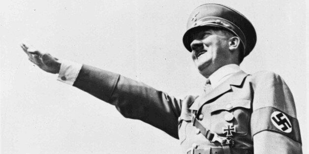 FILE - In this July 31, 1938, file photo German Chancellor Adolf Hitler salutes a huge crowd at a sports...