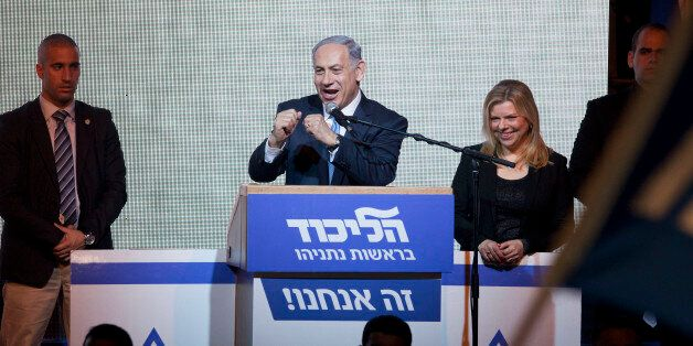 Israeli Prime Minister Benjamin Netanyahu greets supporters at the party's election headquarters In Tel...
