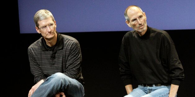 FILE - This July 16, 2010 photo shows Apple's Tim Cook, left, and Steve Jobs, right, during a meeting...