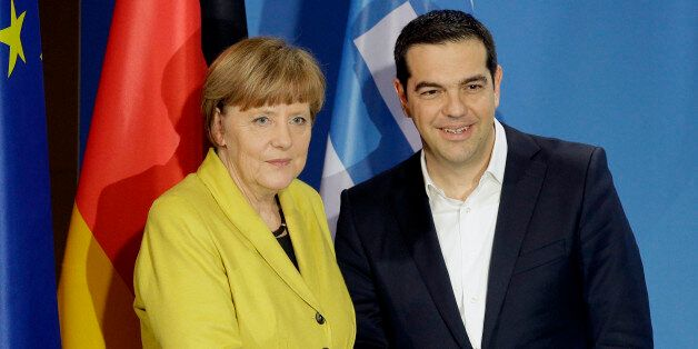 German Chancellor Angela Merkel, and the Prime Minister of Greece, Alexis Tsipras, right, shake hands...