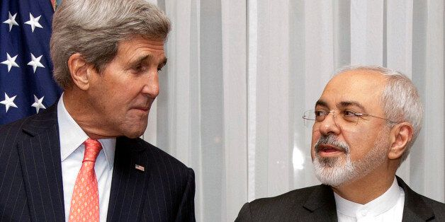 U.S. Secretary of State John Kerry, left, listens to Iran's Foreign Minister Mohammad Javad Zarif, right,...