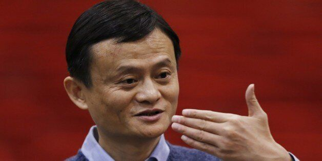 """Alibaba Group Executive Chairman Jack Ma speaks to the media after a speech on """"Transforming Dreams..."""