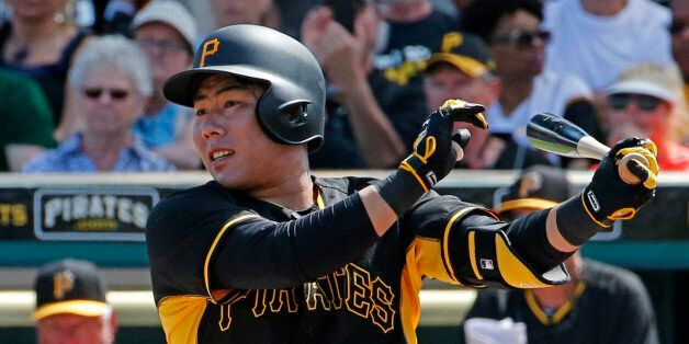 Pittsburgh Pirates' Jung Ho Kang of Korea hits a double during a spring training exhibition baseball...