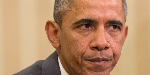 President Barack Obama pauses while speaking about Iran and Israeli Prime Minister Benjamin Netanyahu's...