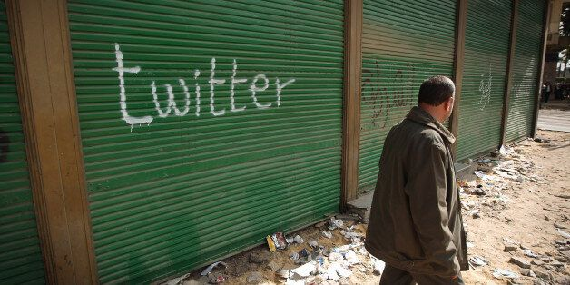 CAIRO, EGYPT - FEBRUARY 04: A shop in Tahrir Square is spray painted with the word Twitter after the...