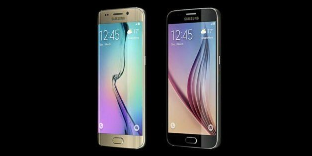 JK Shin, CEO of Samsung's mobile division, shows the new Galaxy S6 and S6 Edge, during a Samsung Galaxy...