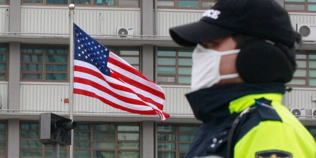 A South Korean police officer stands guard near the U.S. Embassy in Seoul, South Korea, Thursday, March...