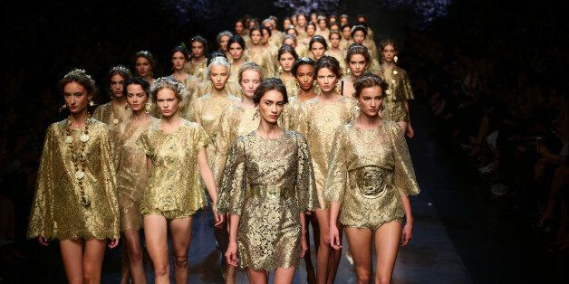 MILAN, ITALY - SEPTEMBER 22: Models walk the runway during the Dolce & Gabbana show as part of Milan...