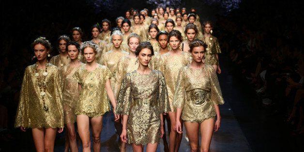 MILAN, ITALY - SEPTEMBER 22: Models walk the runway during the Dolce & Gabbana show as part of Milan...