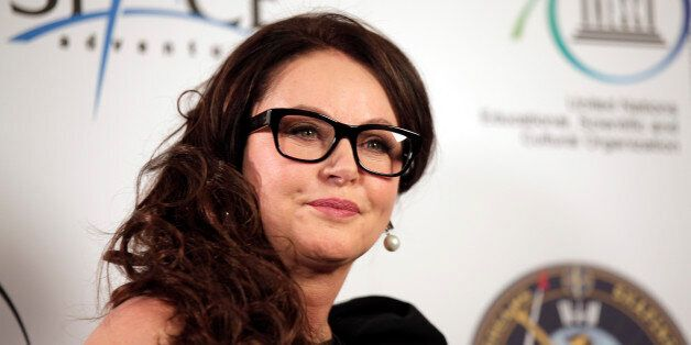 British singer Sarah Brightman poses for the photographers following a news conference, in central London,...