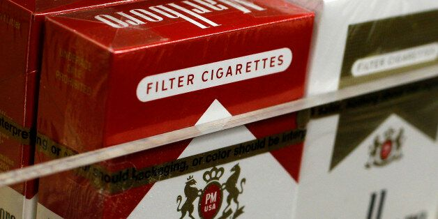 Pictured are packs of cigarettes waiting to be purchased at a Chicago area news stand Friday, Nov. 30,...