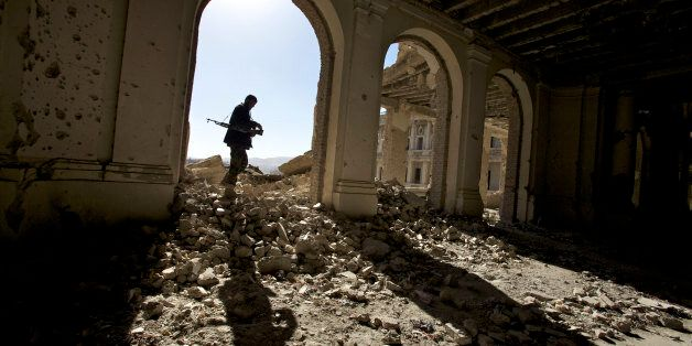 An Afgan national Army soldier walks throgh the ruins of the royal palace, also knows as Afghan president...