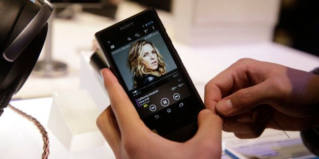 An attendee holds Sony's new Walkman at the Sony booth at the International CES Monday, Jan. 5, 2015,...