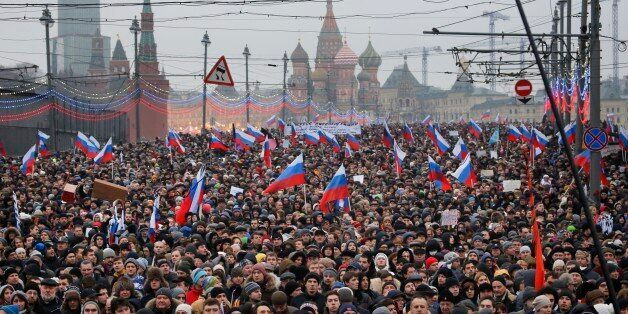 People carry Russian national flags during a march in memory of opposition leader Boris Nemtsov who was...