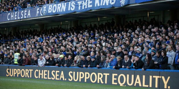 Chelsea fans watch an English Premier League soccer match against Burnley at the Stamford Bridge ground...