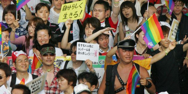Gays and lesbians take part in the Tokyo Gay and Lesbian Parade, which was revived after a halt for two...