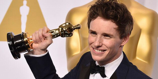 Eddie Redmayne poses in the press room with the award for best actor in a leading role