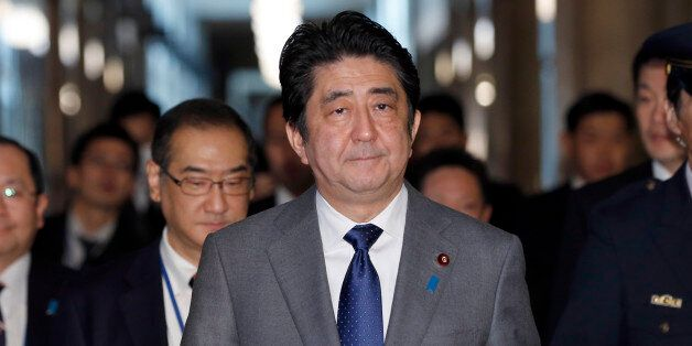 Japan's Prime Minister Shinzo Abe, center, arrives to attend a Diet session at the upper house of Parliament...