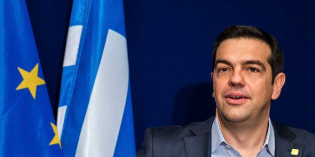 Greek Prime Minister Alexis Tsipras speaks during a media conference after an EU summit in Brussels on...