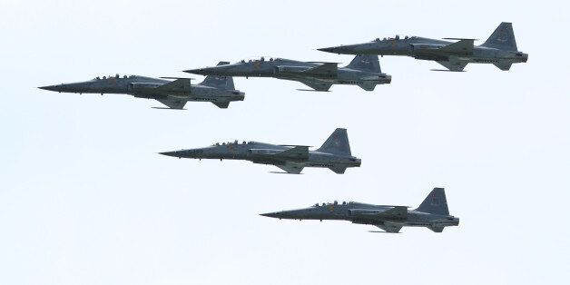 A fleet of F-5 Fighters does a flyby in formation over the Chihang airport during an air show of Taiwan...