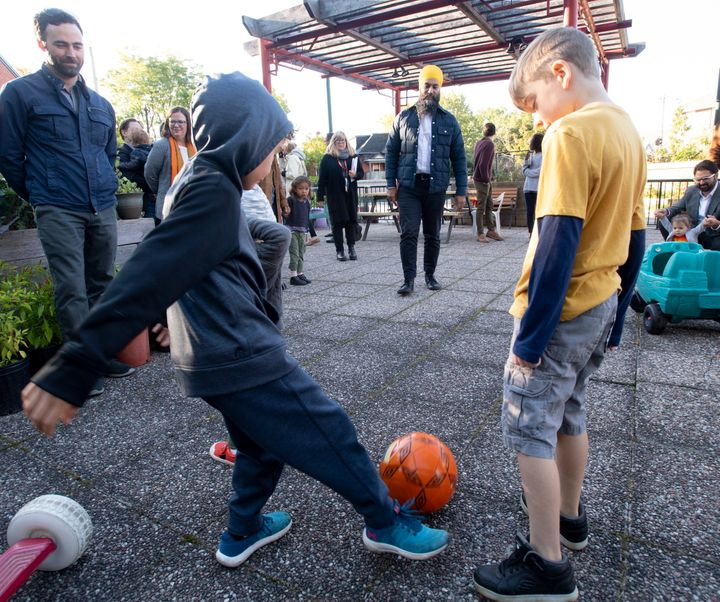 NDP Leader Jagmeet Singh plays soccer with children during a campaign stop in Ottawa on Tuesday. Singh says the NDP wants to help Canadians with no-cost, energy-efficiency upgrades.