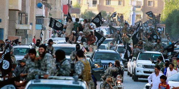 FILE - In this undated file image posted on Monday, June 30, 2014, by the Raqqa Media Center of the Islamic...