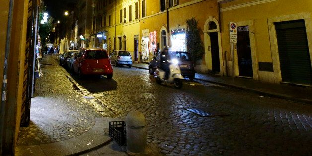 The wall, left, where the image depicting Pope Francis as Superman was posted, is seen empty at the Borgo...