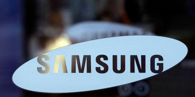 In this Jan. 8, 2013 file photo, Samsung Electronics Co. logo is seen at a showroom of its headquarters...