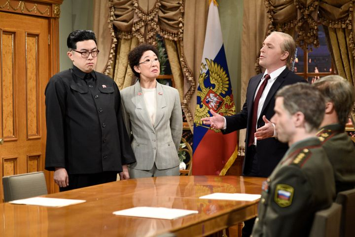 Bowen Yang as Kim John Un, Host Sandra Oh as a North Korean Interpreter and Beck Bennett as Vladimir Putin 'SNL.'