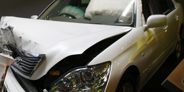 Crashed cars with airbags deployed are shown to visitors as part of the display of Toyota Motor Corp.'s...