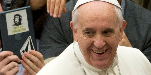 Pope Francis arrives for his weekly general audience in the Pope Paul VI hall, at the Vatican, Wednesday,...