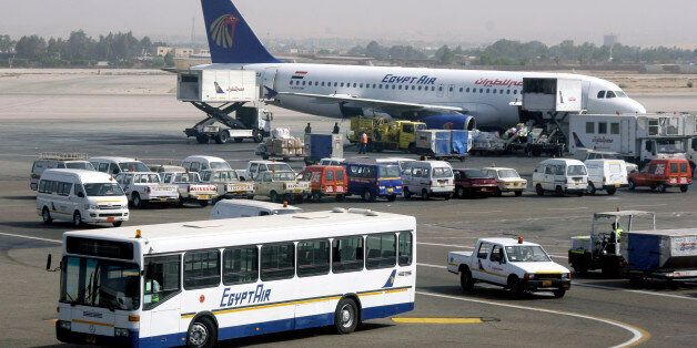 FILE - In this Monday April 21, 2008 file photo, a bus and a plane are seen at the Cairo International...
