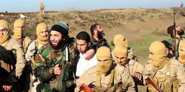 FILE - This Wednesday, Dec. 24, 2014 file image posted by the Raqqa Media Center, which monitors events...