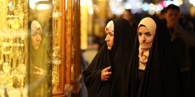 In this Thursday, Jan. 8, 2015 photo, people shop at a jewelry shop in the holy city of Najaf, 100 miles...