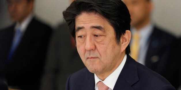 Japan's Prime Minister Shinzo Abe reacts at a meeting on two Japanese hostages taken by the Islamic State...