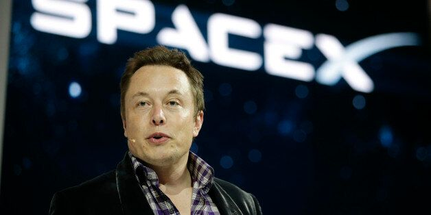 File - In this May 29, 2014 file photo, Elon Musk, CEO and CTO of SpaceX, introduces the SpaceX Dragon...