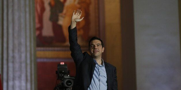 Leader of Syriza left-wing party Alexis Tsipras waves to his supporters outside Athens University Headquarters,...