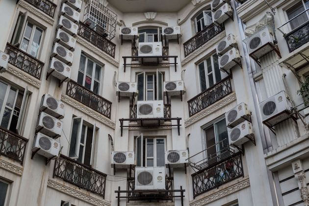Apartment buildings are covered with air conditioning units in Tianducheng, a residential community in...