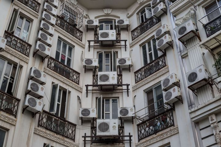 Apartment buildings are covered with air conditioning units in Tianducheng, a residential community in Zhejiang Province, Chi