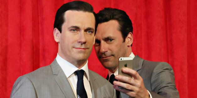 NEW YORK, NY - MAY 09: Actor Jon Hamm takes a selfie as he unveils Don Draper's wax figure during Mad...
