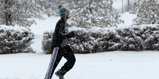 Christopher Joseph, a Rutgers University student, jogs along a road in South Brunswick, N.J., during...