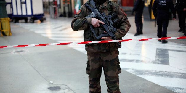 A French soldier patrols at the Gare du Nord railway station, in Paris, France, Thursday, Jan. 8, 2015....