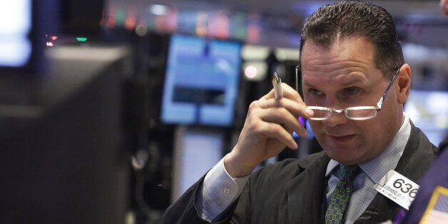 Trader Edward Curran works on the floor of the New York Stock Exchange Monday, Jan. 5, 2015. US stocks...
