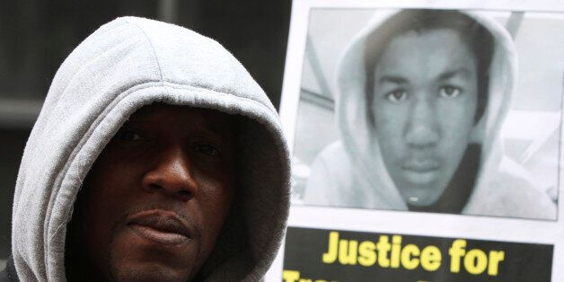 An Occupy Wall Street activist wears a hoodie in honor of Trayvon Martin during a march and rally to...