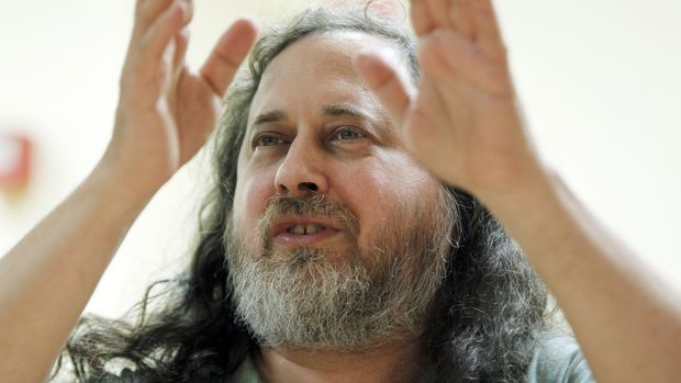 """US software freedom activist and computer programmer Richard Stallman speaks with French Green Party """"Europe Ecologie les Verts"""" (EELV)'s candidate for 2012 French presidential election Eva Joly at the EELV's headquarters in Paris on December 15, 2011. Stallman launched in 1983 the GNU Project to create a free Unix-like operating system and he has been the project's lead architect and organizer. With the launch of the GNU Project, he initiated the free software movement and founded the Free Software Foundation in 1985. AFP PHOTO FRANCOIS GUILLOT (Photo credit should read FRANCOIS GUILLOT/AFP/Getty Images)"""