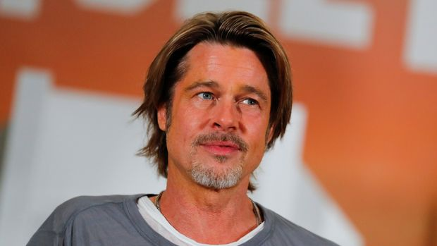 "Cast member Brad Pitt poses for a picture as he takes part in a photo call for the movie ""Once Upon a Time in Hollywood""  in Beverly Hills, California, U.S. July 11, 2019. REUTERS/Mike Blake"